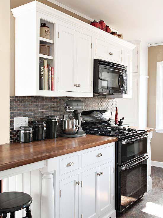 white kitchen with black appliances.jpg